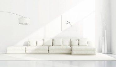 White_minimalist_living_room_with_elegant_sofa,floor_lamp_and_clock_-_3D_Rendering