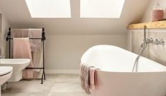 Beautiful_attic_bathroom_in_pastel_and_nude_colours,_with_spectacular_oval_bath