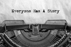 Everyone_Has_A_Story,_typed_words_on_a_vintage_typewriter._old_paper._close-up._my_history