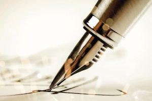 Signing_a_signature_with_a_fountain_pen