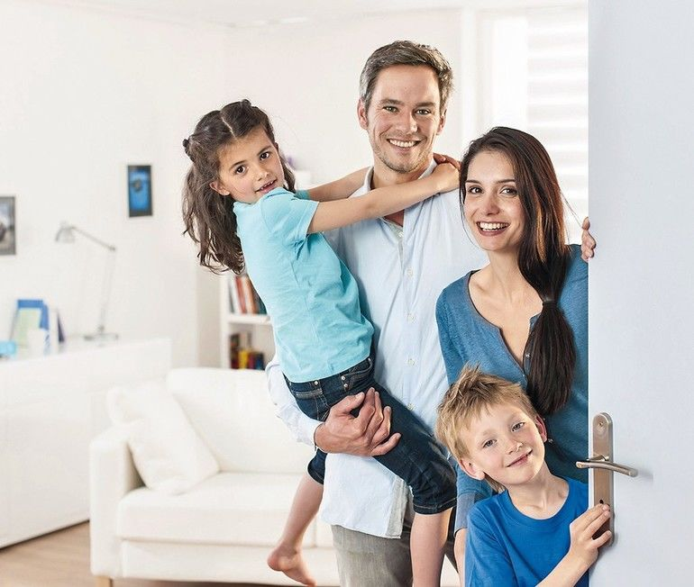 Family_standing_at_front_door_to_invite_people_at_home