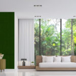 Modern_white_bedroom_and_living_room_with_nature_view_3d_render_image.There_are_white_floor_.There_are_large_window_overlooking_to_the_garden_and_nature_and_furnished_with_wood_furniture