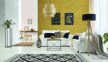 Apartment_with_white_brick_wall,_sofa,_table_and_pattern_rug