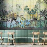 Dark_gray_wall_cafe_interior_with_a_concrete_floor,_and_wooden_tables_with_chairs._Green_sofas._3d_rendering_mock_up