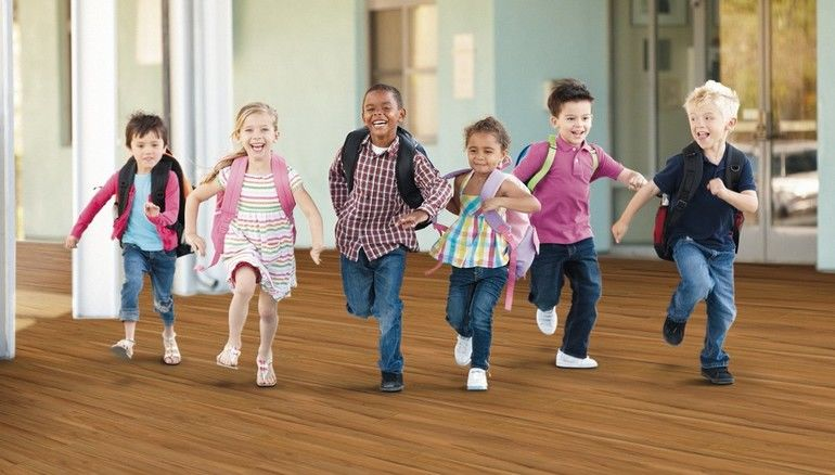 Group_Of_Elementary_Age_Schoolchildren_Running_Outside
